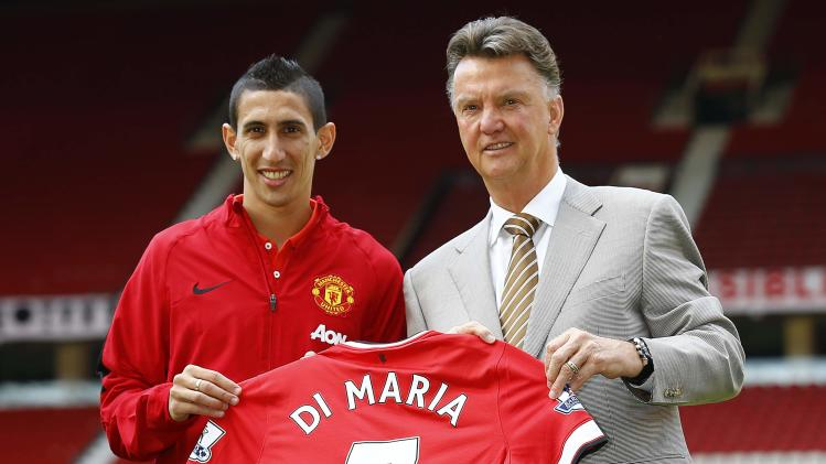 Manchester United's new signing Angel Di Maria poses for a photograph with manager Louis van Gaal at Old Trafford in Manchester
