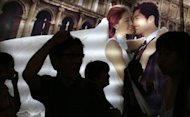 People attend a wedding exhibition in downtown Shanghai June 16, 2013. REUTERS/Carlos Barria/Files