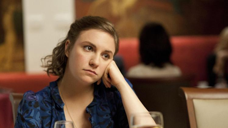 "This undated image released by HBO shows Lena Dunham in a scene from the series ""Girls."" Dunham created, wrote, directed, produced and starred in a half-hour comedy series about 20-something adulthood, femininity and sexuality.  (AP Photo/HBO, JoJo Whilden)"