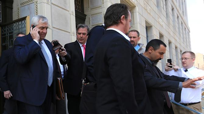 """Robert K. Mericle, left, leaves the William J. Nealon Federal Building and U.S. Courthouse in Scranton, Pa., after being sentenced to one year in prison on Friday, April 25, 2014. Mericle, a builder of for-profit youth detention centers, was sentenced for his role in a """"kids for cash"""" scandal in which thousands of juveniles were sent to his facilities by judges who took money from him. He was also fined $250,000 and ordered to serve 100 hours of community service.(AP Photo/ The Times-Tribune, Jake Danna Stevens) WILKES BARRE TIMES-LEADER OUT; MANDATORY CREDIT"""