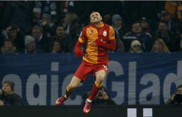 Galatasaray's Yilmaz celebrates a goal against Schalke 04 during the Champions League soccer match in Gelsenkirchen