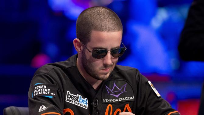 Greg Merson contemplates his next move during the World Series of Poker Final Table event, Tuesday, Oct. 30, 2012, in Las Vegas. (AP Photo/Julie Jacobson)