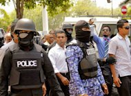 Former Maldives president Mohamed Nasheed (C, in white) is arrested in Male on March 5, 2013. Police in the Maldives said Wednesday they have arrested scores of opposition supporters protesting at the detention of former president Mohamed Nasheed before his court appearance on abuse of power charges