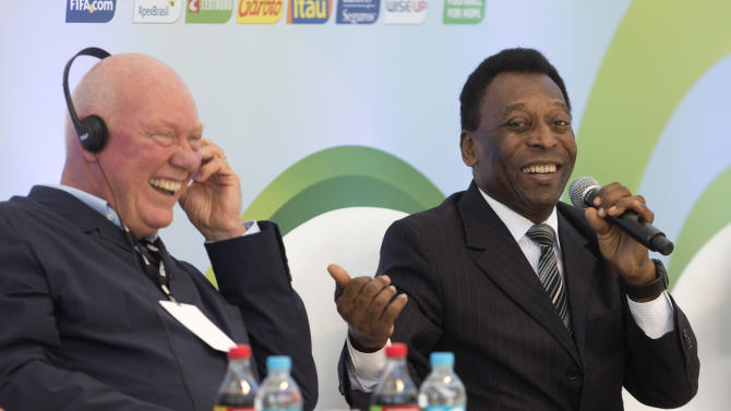 Brazilian football icon Pele, right, jokes with Hublot Chairman Jean-Claude Biver during an event marking one year to the kick-off of the 2014 World Cup, at the Copacabana beach in Rio de Janeiro, Brazil, Wednesday, June 12, 2013. (AP Photo/Silvia Izquierdo)