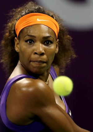 Serena Williams of the U.S. returns the ball to Russia's Maria Sharapova in the semifinal of the WTA Qatar Ladies Open tennis tournament in Doha, Qatar, Saturday, Feb. 16, 2013. (AP Photo/Osama Faisal)