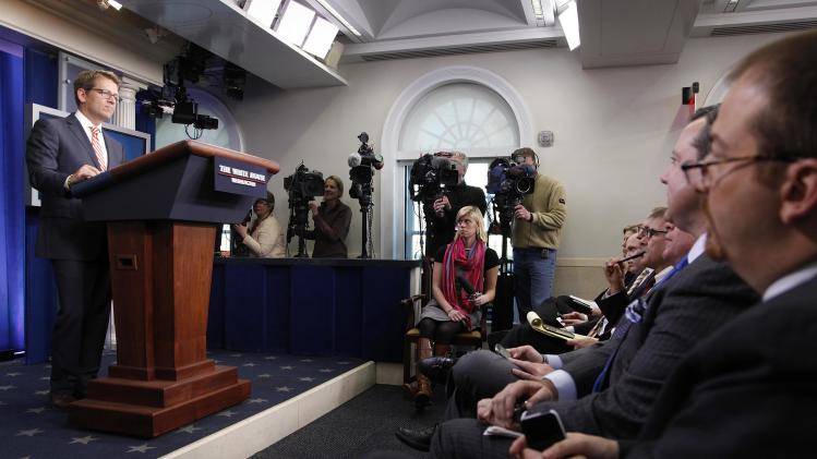 Carney answers questions during the daily briefing at the White House in Washington