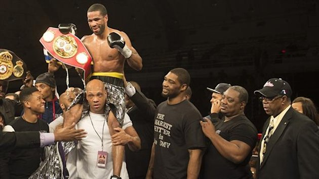 Lamont Peterson celebrates after stopping Kendall Holt to retain the IBF Junior Welterweight World Championship in Washington (AFP)