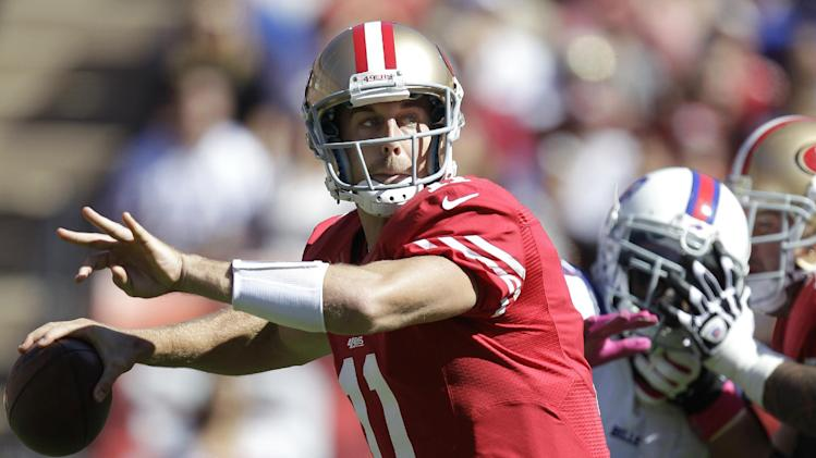 San Francisco 49ers quarterback Alex Smith (11) passes against the Buffalo Bills during the first quarter of an NFL football game, Sunday, Oct. 7, 2012, in San Francisco. (AP Photo/Tony Avelar)
