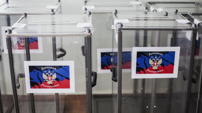 Ballot boxes stand already bearing the flag of Donetsk People's Republic at a polling station, in preparation for the upcoming referendum in the center of Donetsk, Ukraine, Saturday, May 10, 2014. Two restive regions in eastern Ukraine are preparing to vote on declaring sovereignty and ceding from Ukraine, in a referendum on Sunday in the Donetsk and Luhansk regions, where pro-Russia insurgents have seized government buildings and clashed with police and Ukrainian troops. (AP Photo/Manu Brabo)
