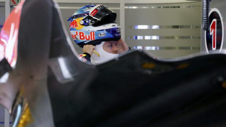 Red Bull Formula One driver Vettel of Germany puts on his helmet ahead of the qualifying session for the Australian F1 Grand Prix in Melbourne