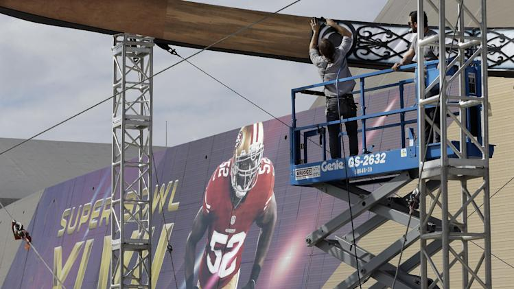 Workers build a structure outside the Mercedes-Benz Superdome on Monday, Jan. 28, 2013, in New Orleans. The San Francisco 49ers are scheduled to face the Baltimore Ravens in the NFL Super Bowl XLVII football game on Feb. 3. (AP Photo/Mark Humphrey)