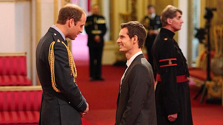 Wimbledon champion Andy Murray, right, receives his Order of the British Empire (OBE) medal from the from Britain's Prince William, during an Investiture ceremony at Buckingham Palace, London Thursday Oct. 17, 2013. This is the first occasion that Prince William has officiated at a Royal Investiture. (AP Photo/Jonathan Brady/PA) UNITED KINGDOM OUT