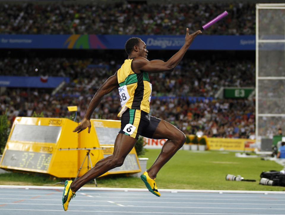 Jamaica's Usain Bolt throws the baton into the air as he celebrates winning the Men's 4x100 Relay final and setting a world record at the World Athletics Championships in Daegu, South Korea, Sunday, Sept. 4, 2011. (AP Photo/Shuji Kajiyama)