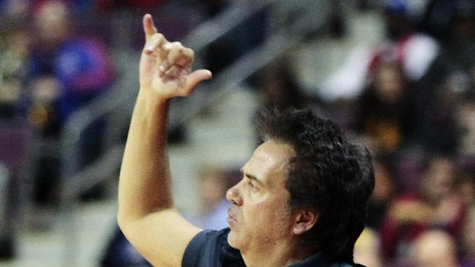 Detroit Pistons owner Tom Gores cheers on his team during the first half of an NBA basketball game against the Houston Rockets, Wednesday, Oct. 31, 2012, in Detroit. (AP Photo/Duane Burleson