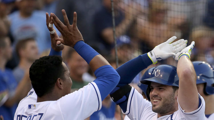 Kansas City Royals' Salvador Perez (13) and Mike Moustakas (8) celebrate after they both hit back-to-back solo home runs during the second inning of a baseball game against the Cleveland Indians, Friday, July 25, 2014, in Kansas City, Mo. (AP Photo/Charlie Riedel)