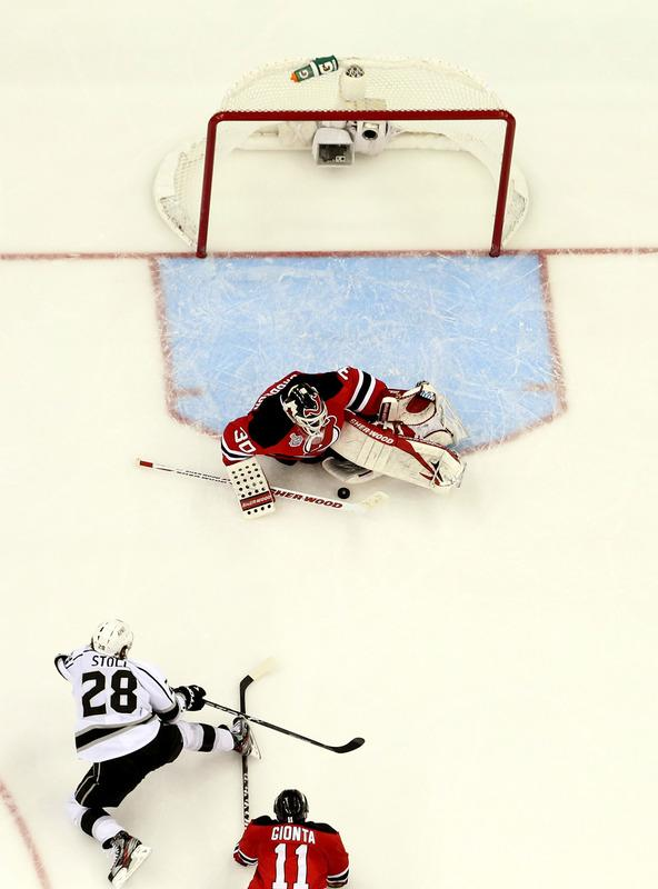 Martin Brodeur #30 Of The New Jersey Devils Makes A Save In Front Of Jarret Stoll #28 Of The Los Angeles Kings And Getty Images