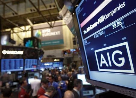 The American International Group, Inc. (AIG) stock ticker is seen on a monitor as traders work on the floor of the New York Stock Exchange after the opening bell February 11, 2013. REUTERS/Brendan McD