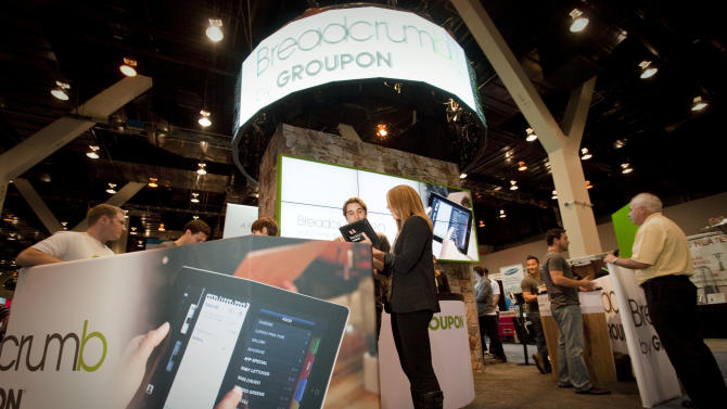 IMAGE DISTRIBUTED FOR GROUPON - Groupon booth is seen at the National Restaurant Association Tradeshow at McCormick Place, on Sunday, May 19, 2013 in Chicago. Groupon highlights the company's marketing and Breadcrumb by Groupon point-of-sale and payments at the tradeshow. (John Konstantaras / AP Images for Groupon)