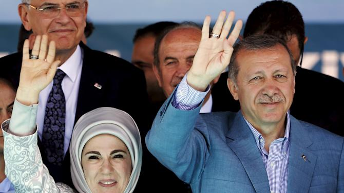 Turkey's President Erdogan, accompanied by his wife Emine, greets supporters during an opening ceremony in Istanbul, Turkey