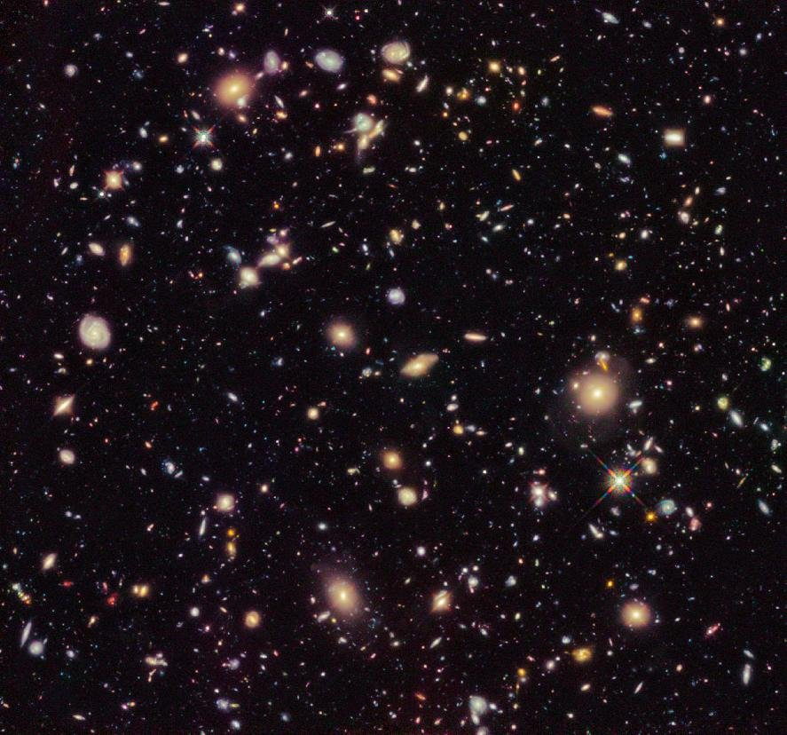 In this image provided by NASA and taken by the Hubble Space Telescope shows previously unseen early galaxies including the oldest one at 13.3 billion years old. Launched in 1990, Hubble has peered de