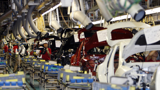 FILE - In this July 2, 2011, file photo, Nissan Motor Co. employees work on cars on the assembly line at the Japanese automaker's Oppama plant in Yokosuka near Tokyo. Nine Japanese auto parts manufacturers and two of their executives will plead guilty and pay $740 million in criminal fines for conspiring to fix the prices of more than 30 products sold to many of the world's largest automakers operating in the U.S., the Justice Department announced Thursday, Sept. 26, 2013. (AP Photo/Shuji Kajiyama)