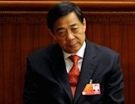 Fallen top politician Bo Xilai, pictured in March 2012, knew his wife was suspected of murdering a British businessman, Chinese state media implicitly alleged Wednesday, linking him to a criminal act for the first time