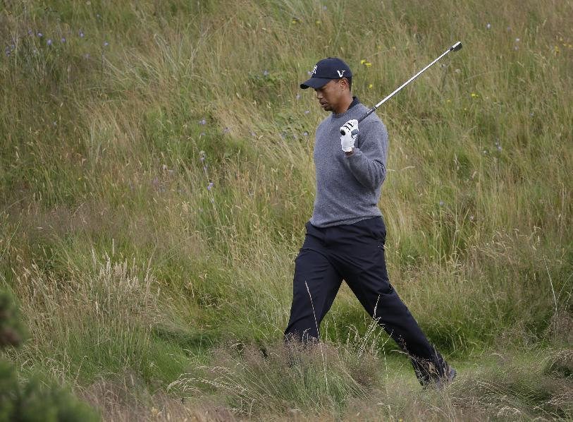 Tiger Woods of the United States walks on after playing a shot off the 11th tee at Royal Lytham & St Annes golf club during the second round of the British Open Golf Championship, Lytham St Annes, England, Friday, July 20, 2012. (AP Photo/Chris Carlson)