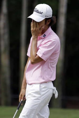 Kevin Na reacts to a bogey on the six hole during the final round of the Players Championship golf tournament at TPC Sawgrass, Sunday, May 13, 2012, in Ponte Vedra Beach, Fla. (AP Photo/David Goldman)