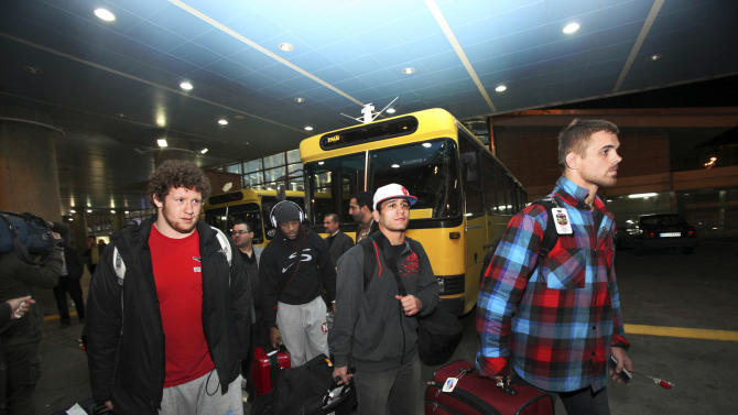 U.S. freestyle wrestling team members arrive at the Imam Khomeini airport in Tehran, Iran, early Tuesday morning, Feb. 19, 2013, to attend World Cup tournament. USA Wrestling has formalized plans for a committee charged with restoring Olympic wrestling. (AP Photo/Vahid Salemi)