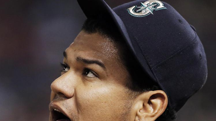 Seattle Mariners starting pitcher Felix Hernandez (34) during a baseball game against the Texas Rangers, Wednesday, April 16, 2014, in Arlington, Texas. Texas won 3-2. (AP Photo/Brandon Wade)