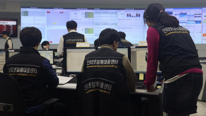 Employees of Korea Internet Security Center work after computer networks at two major South Korean banks and three top TV broadcasters went into shutdown mode en masse, at a monitoring room in Seoul, South Korea, Wednesday, March 20, 2013. Police and South Korean officials investigating the shutdown said the cause was not immediately clear. But speculation centered on North Korea, with experts saying a cyberattack orchestrated by Pyongyang was likely to blame. (AP Photo/Yonhap, Han Jong-chan)  KOREA OUT