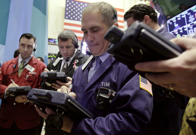 In this Wednesday, Oct. 3, 2012, file photo, traders work on the floor of the New York Stock Exchange. A pair of encouraging economic reports helped nudge the stock market higher Wednesday. Measures of business activity in the service sector and job growth last month came in better than economists had expected. (AP Photo/Richard Drew)