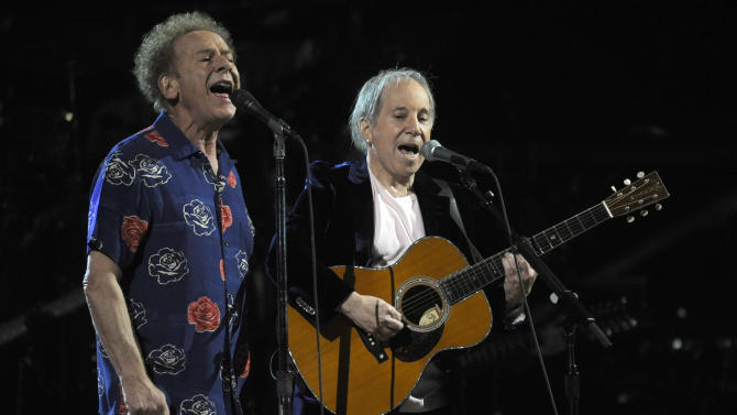 """FILE - In this Oct. 29, 2009 file photo, Paul Simon, right, and Art Garfunkel perform at the 25th Anniversary Rock & Roll Hall of Fame concert at Madison Square Garden in New York. On Thursday, March 21, 2013 the library is announcing its newest additions to the National Recording Registry. The 1966 album """"Sounds of Silence"""" by Paul Simon and Art Garfunkel is among them. (AP Photo/Henny Ray Abrams, File)"""