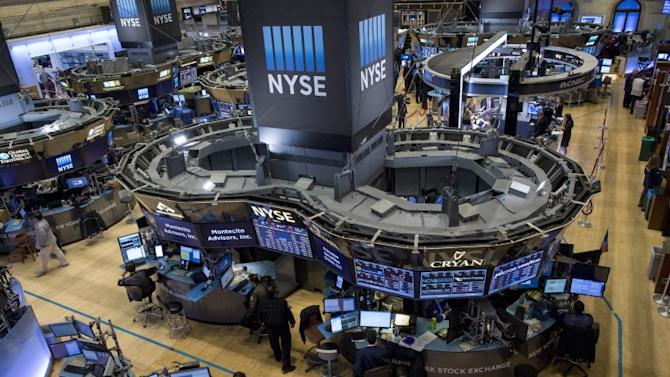 'Traders work on the floor of the New York Stock Exchange' from the web at 'http://l1.yimg.com/bt/api/res/1.2/x5ThJrFPHTnLrCCq_.np0A--/YXBwaWQ9eW5ld3NfbGVnbztmaT1maWxsO2g9Mzc3O2lsPXBsYW5lO3B4b2ZmPTUwO3B5b2ZmPTA7cT03NTt3PTY3MA--/http://globalfinance.zenfs.com/images/US_AHTTP_REUTERS_OLUSBUS_WRAPPER_H_LIVE_NEW/2015-11-17T165226Z_1_LYNXNPEBAG0Z4_RTROPTP_3_USA-STOCKS_original.jpg'