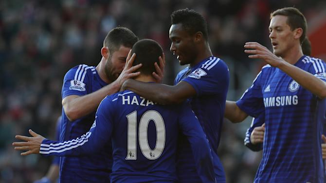 Chelsea's Eden Hazard is congratulated by his teammates after scoring a goal during the English Premier League soccer match between Southampton and Chelsea at St Mary's Stadium, Southampton, England, Sunday, Dec. 28, 2014. (AP Photo/Tim Ireland)