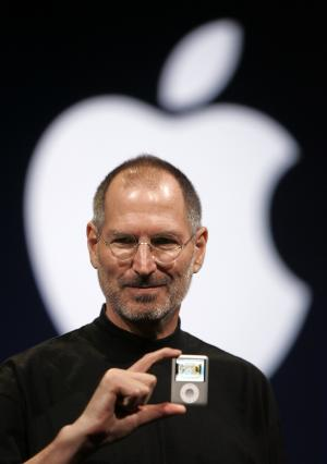FILE - In this Sept. 5, 2007, file photo, Apple CEO Steve Jobs introduces the Apple Nano in San Francisco. Walter Isaacson's authorized biography of Steve Jobs comes out on Oct. 24. (AP Photo/Paul Sakuma, File)