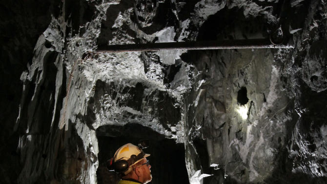 In this photo taken Thursday, Dec. 13, 2012,  Matt Collins, chief operating officer of the Sutter Gold Mining Co., inspects one of the gold mining tunnels operated by the company near Sutter Creek, Calif.  The company, which has begun mining adjacent to the historic Comet-Lincoln ore zones,  announced Monday, Dec. 17, 2012, that it poured its first gold as it prepared to begin the first large scale Sierra Nevada underground  gold mining in a half century. (AP Photo/Rich Pedroncelli)