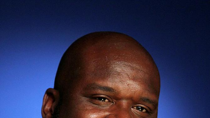 """This Oct. 18, 2012 photo shows four-time NBA champion Shaquille O'Neal in New York. O'Neal is providing a forum for comics for his """"All Star Comedy Jam"""" tour.  The twenty-city tour includes urban comics Kevin Hart, Finesse Mitchell, and Gary Owen. The tour ends on New Year's Eve in Atlanta.(AP Photo/John Carucci)"""