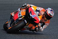 Repsol Honda Team's Australian Casey Stoner rides at the Catalunya racetrack in Montmelo. Stoner will start on pole in the Catalunya motorcycling Grand Prix Sunday after the Honda rider posted the quickest time in qualifying under the sun at the Montmelo circuit