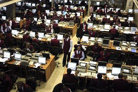 Brokers work on the trading floor of the Nigerian stock exchange in the commercial capital Lagos April 28, 2010. REUTERS/Akintunde Akinleye