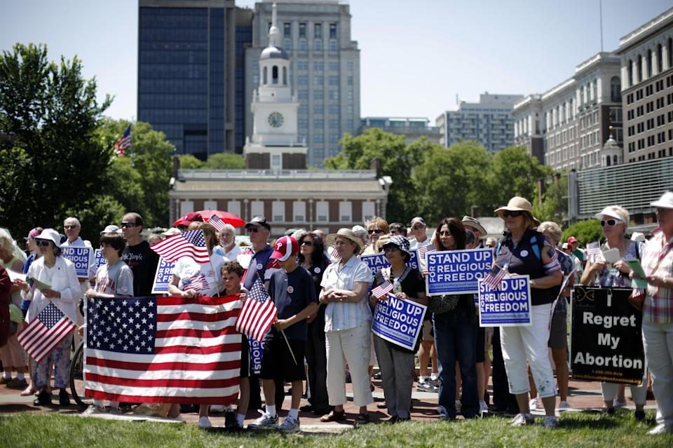Demonstrators protest against the Obama administration mandate that employers provide workers birth control coverage, in view of Independence Hall, Friday, June 8, 2012, in Philadelphia. The event was organized by Stand Up For Religious Freedom. (AP Photo/Matt Rourke)