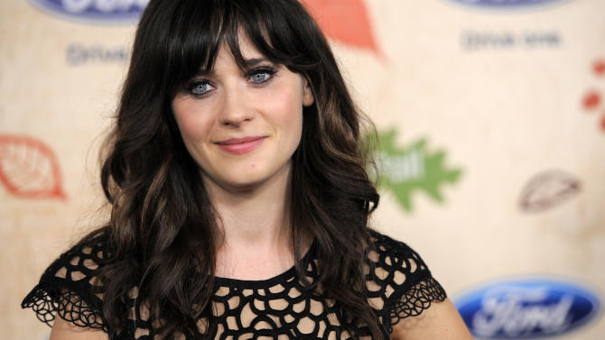 """In this Monday, Sept. 12, 2011 file photo, Zooey Deschanel, a cast member in the television series """"New Girl,"""" poses at the 7th Annual FOX Fall Eco-Casino Party in Culver City, Calif. The event raised money and awareness for environmental causes while celebrating the launch of the FOX fall television season. (AP Photo/Chris Pizzello)"""