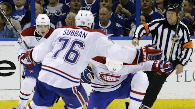 Montreal Canadiens right wing Dale Weise (22) celebrates with teammates P.K. Subban (76) and Daniel Briere (48) after scoring against the Tampa Bay Lightning during overtime of Game 1 of a first-round NHL hockey playoff series on Wednesday, April 16, 2014, in Tampa, Fla