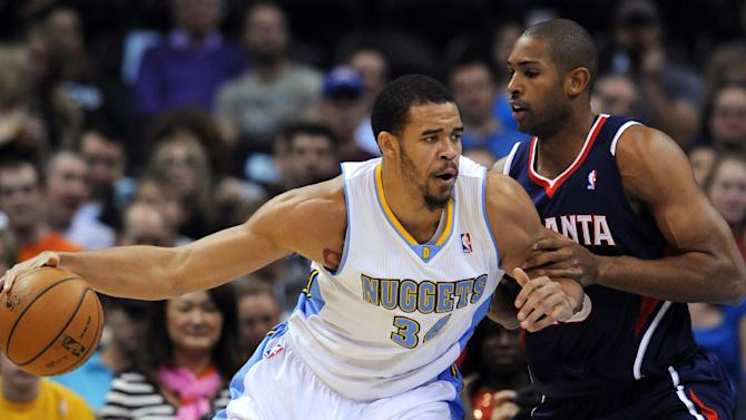 Denver Nuggets center JaVale McGee (34) bumps Atlanta Hawks center Al Horford, right, from the Dominican Republic during the first quarter of an NBA basketball game Thursday, Nov. 7, 2013, in Denver. (AP Photo/Jack Dempsey)