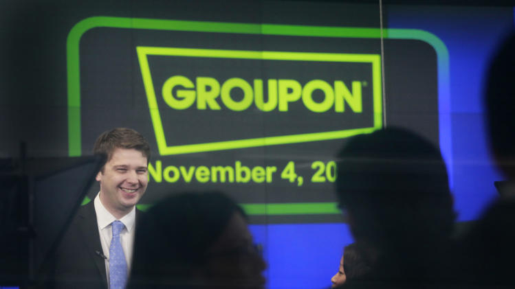 Andrew Mason, founder and CEO of Groupon, attends his company's IPO at Nasdaq, Friday, Nov. 4, 2011, in New York. Groupon, the company that pioneered online group discounts, has begun trading as a public company. The stock jumped nearly 50 percent in the opening minutes Friday. (AP Photo/Mark Lennihan)
