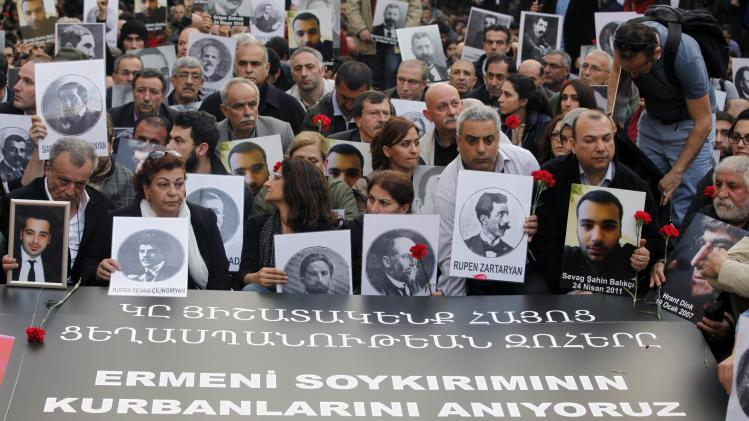 Activists hold pictures of Armenian victims during a demonstration to commemorate the 1915 mass killing of Armenians, in Istanbul