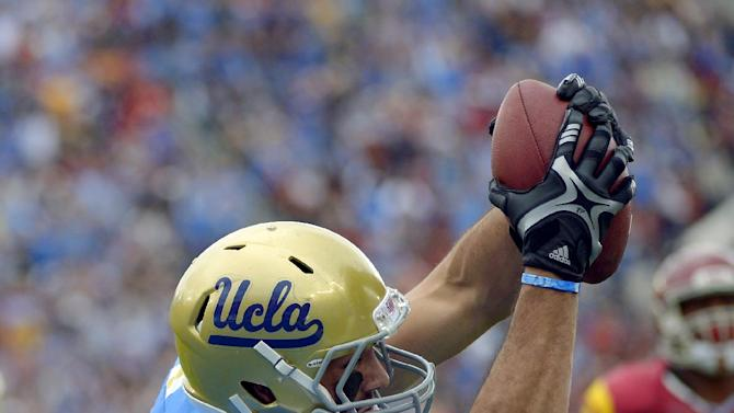 UCLA tight end Joseph Fauria, top, scores a touchdown as  Southern California safety Jawanza Starling tries to make the stop during the first half of an NCAA college football game, Saturday, Nov. 17, 2012, in Pasadena, Calif. (AP Photo/Mark J. Terrill)