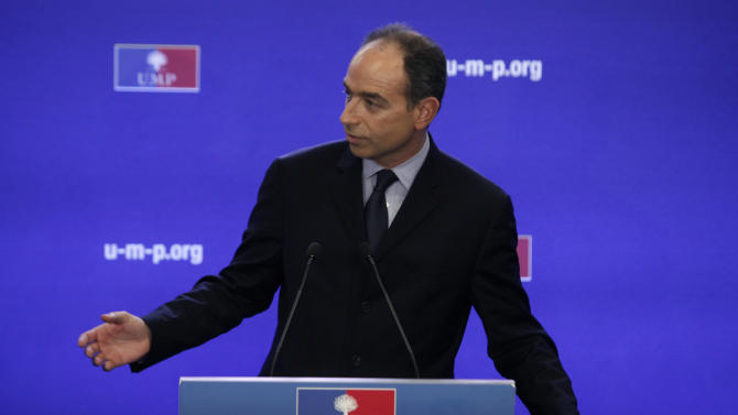 Newly elected president of UMP (Union for a Popular Movement) Jean-Francois Cope gestures as he gives a press conference, at the UMP headquarter, in Paris, Monday, Nov. 26, 2012. (AP Photo/Thibault Camus)