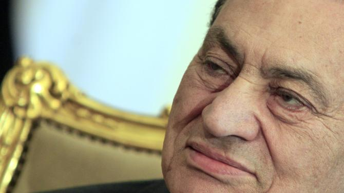 FILE - In this Tuesday, Feb. 8, 2011 file photo, the Egyptian President Hosni Mubarak sits during his meeting with Emirates foreign minister, not pictured, at the Presidential palace in Cairo, Egypt. Egypt's state news agency says the country's top prosecutor has ordered ousted President Hosni Mubarak be detained for 15 days pending investigation into a new case of corruption by him and his family for pocketing state funds slated for the presidential palaces. Mubarak, 84, in detention since April 2011, is currently held in a military hospital because of health issues. (AP Photo/Amr Nabil, File)
