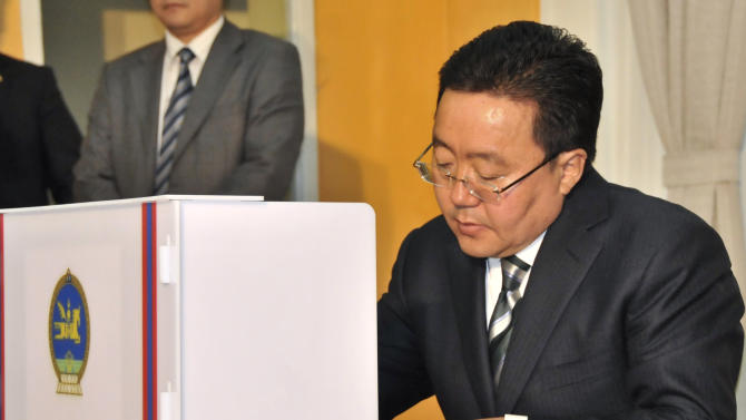 Mongolia's President Tsakhiagiin Elbegdorj fills out a ballot at a polling station in Ulan Bator, Mongolia, Thursday, June 28, 2012. Mongolians are voting for a new legislature, going to the polls by foot, car and even horse for an election centered on how best to distribute the benefits of Mongolia's mining boom. (AP Photo/B. Tserentsamts)